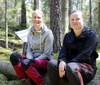Angelica Weisner and Rebecca Peterson, sitting in the woods.